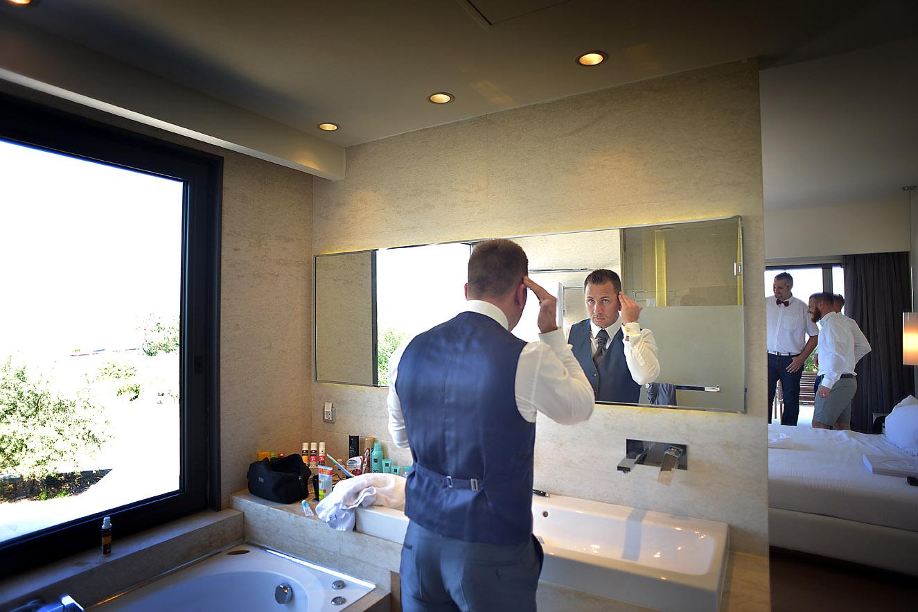 groom-preparation-gettin-ready-hotel-olympus-cavo-07